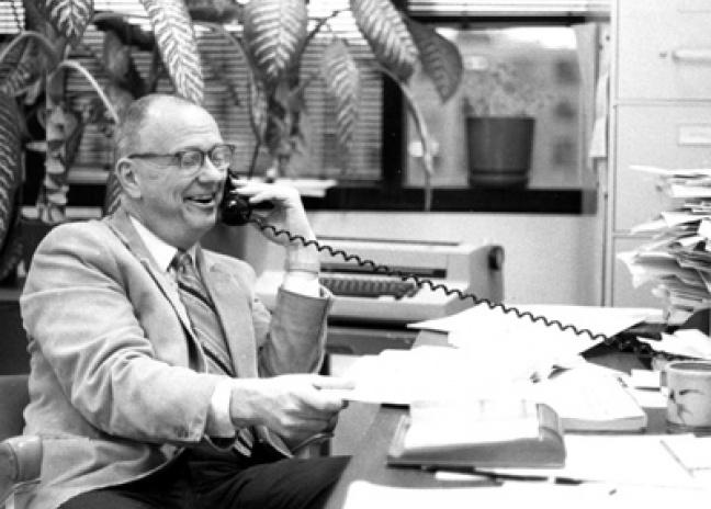 Arthur C. Smith on telephone